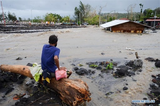A man looking at the floods after typhoon Goni hit the Philippines