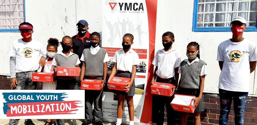 Kids in South Africa holding shoe box, from the School Shoe Campaign