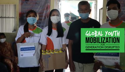 young people wearing masks from YMCA Cambodia holding goods they distribute to their communities